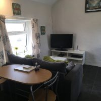 Ty'n Llan Outbuilding Living Dining Area